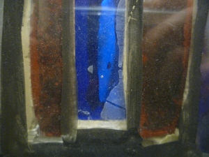 Remains of silicone on the glass and plaster (exterior of panel) - also note the dust on the surface of the glass