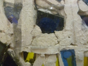 Evidence of adhesive on the glass. This can be used to determine where glass pieces have fallen from.
