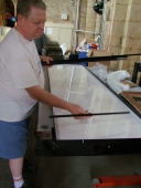 Neil showing us how the LED panel for St Anthony fits in the frame